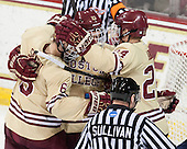 Steven Santini (BC - 6), Patrick Brown (BC - 23) and Bill Arnold (BC - 24) celebrate. - The Boston College Eagles defeated the visiting University of Notre Dame Fighting Irish 4-2 to tie their Hockey East quarterfinal matchup at one game each on Saturday, March 15, 2014, at Kelley Rink in Conte Forum in Chestnut Hill, Massachusetts.