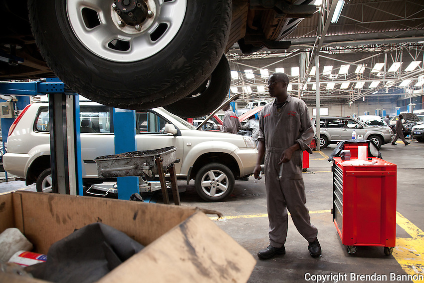 The workshop at DT Dobie in Nairobi Kenya. The workshop mechanics repair over 60 Nissan cars per day.