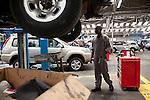 The workshop at DT Dobie in Nairobi Kenya. The workshop mechanics repair over 60 Nissan cars per day.