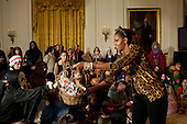 Washington, DC - October 31, 2009 -- First Lady Michelle Obama hands out treats during a Halloween reception for military families and children of White House staff in the East Room of the White House, October 31, 2009. .Mandatory Credit: Pete Souza - White House via CNP