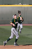 Jake Miller #20 of the Baylor Bears catches a pop fly against the UCLA Bruins at Jackie Robinson Stadium on February 25, 2012 in Los Angeles,California. UCLA defeated Baylor 9-3.(Larry Goren/Four Seam Images)