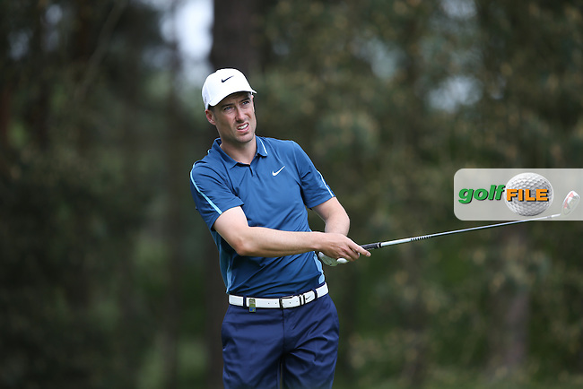 Ross Fisher (ENG) drives to the 8th during Round Two of the 2015 BMW PGA Championship over the West Course at Wentworth, Virginia Water, London. 22/05/2015Picture David Lloyd, www.golffile.ie.