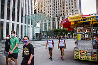 NEW YORK, NY - AUGUST 19: People walk pass in front of the Apple store on Fifth Avenue on August 19 2020 in New York City. Tech giant Apple has become the first American company to boast a $2 trillion market value, after just two years becoming the first to reach $1 trillion (Photo by Pablo Monsalve / VIEWpress via Getty Images)