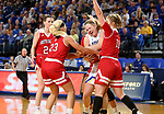 BROOKINGS, SD - FEBRUARY 22: Sydney Stapleton #35 of the South Dakota State Jackrabbits is tied up with Madison McKeever #23 while teammate Monica Arens #11 of the South Dakota Coyotes defends Saturday at Frost Arena in Brookings, SD. (Photo by Dave Eggen/Inertia)