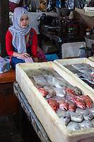 Bali, Indonesia.  Jimbaran Fish Market Vendor.
