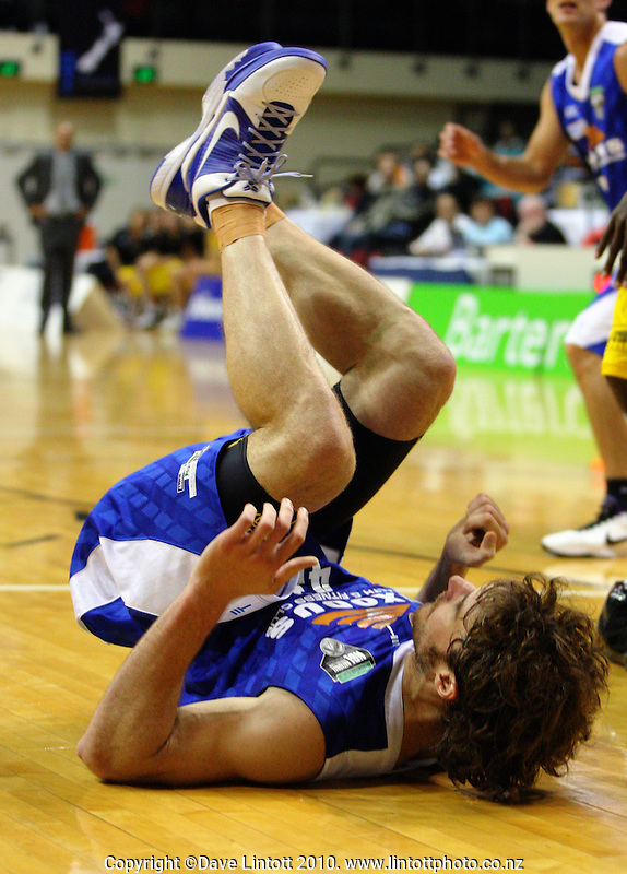 Saints forward Casey Frank takes a tumble during the National basketball league match between the Wellington Saints  and Taranaki Mountainairs at TSB Bank Arena, Wellington, New Zealand onFriday, 9 April 2010. Photo: Dave Lintott / lintottphoto.co.nz