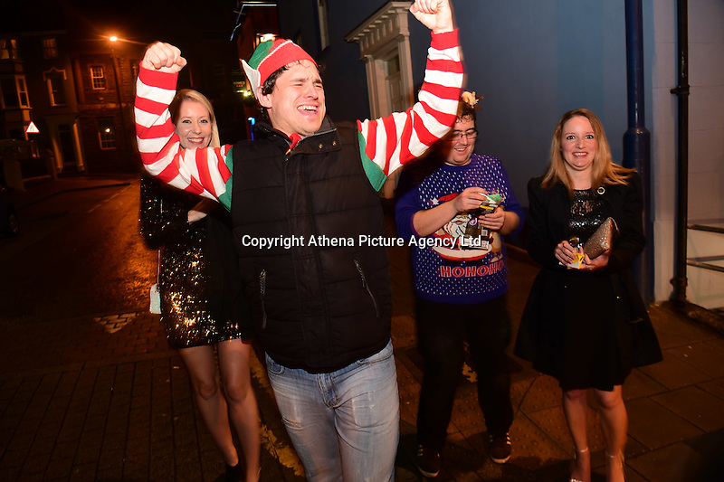 People out on 'Booze Black Friday' or 'Mad Friday', the last Friday before Christmas when workers celebrate with their colleagues . Alcohol sales in pubs, clubs and off-licences rise dramatically on this day. Aberystwyth, Wales, UK. Friday  16 December 2016
