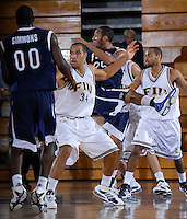 Florida International University Golden Panthers versus the Florida Atlantic University Owls at Pharmed Arena, Miami, Florida on Thursday, December 28, 2006.  FAU's DeAndre Rice sunk a three-point shot with 5.9 seconds left in the game to lift the Owls to a 68-66 win over the Golden Panthers...Sophomore forward Marlon Bright (34)<br />