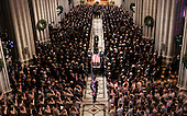 Washington, D.C. - January 2, 2007 -- Former United States President Gerald R. Ford's casket is carried from the Washington National Cathedral in Washington, Tuesday, January 2, 2007 during a State Funeral service. <br /> Credit: Pablo Martinez Monsivais-Pool via CNP