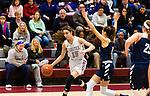 NAUGATUCK,  CT-011820JS09- Naugatuck's Sara Macary (15) drives to the basket past Shepaug's Marissa Perachi (1) during their non-league game Saturday at Naugatuck High School. <br /> Jim Shannon Republican-American