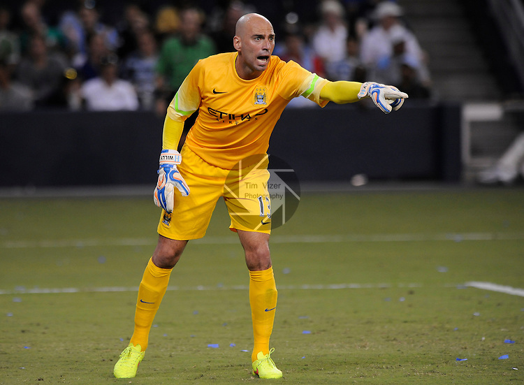 Manchester City goalkeeper Willy Caballero yells to teammates in the second half. Manchester City defeated Sporting KC 4-1 in an international friendly game played at Sporting Park in Kansas City, Kansas on Wednesday July 23, 2014.