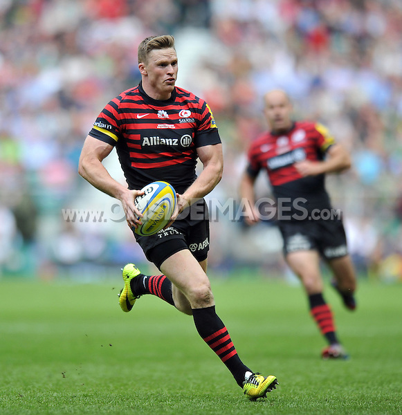 Chris Ashton goes on the attack. Aviva Premiership Final, between Saracens and Northampton Saints on May 31, 2014 at Twickenham Stadium in London, England. Photo by: Patrick Khachfe / JMP