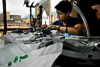 An emerald cutter polishes a gemstone in a cutting and polishing workshop in Bogota, Colombia, 31 March 2006. Approximately 60 percent of the world's total amount of emeralds come from Colombia. Most of the rough gems are processed in workshops located in the emerald district in downtown Bogota. Due to their special clarity and deep vivid green color, Colombian gemstones are considered the most beautiful emeralds in the world.
