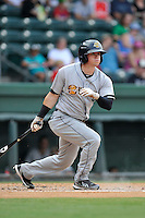 Center fielder Devyn Bolasky (11) of the Charleston RiverDogs bats in a game against the Greenville Drive on Sunday, August 16, 2015, at Fluor Field at the West End in Greenville, South Carolina. Charleston won, 6-2. (Tom Priddy/Four Seam Images)