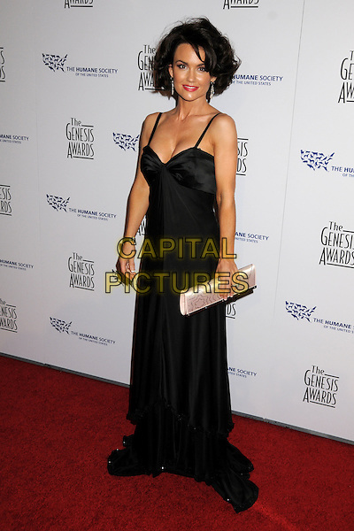 KELLY CARLSON .24th Annual Genesis Awards - Arrivals held at the Beverly Hilton Hotel, Beverly Hills, California, USA, 20th March 2010..full length black long maxi dress white clutch bag .CAP/ADM/BP.©Byron Purvis/AdMedia/Capital Pictures.