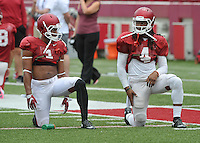 NWA Democrat-Gazette/MICHAEL WOODS &bull; @NWAMICHAELW<br /> University of Arkansas receiver's Jared Cornelius (1) and  Keon Hatcher (4) stretch out during practice Saturday August 22, 2015 at Razorback Stadium in Fayetteville.