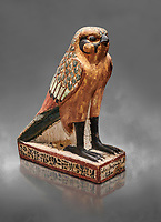 Ancient Egyptian wooden falcon bird, Late Period (722-322 BC), Egyptian Museum, Turin. Cat 986. Grey background. <br /> <br /> Wooden tomb models were an Egyptian funerary custom from the Middle Kingdom in which wooden figurines and sets were constructed to be placed in the tombs of Egyptian royalty. These wooden models represented the work of servants, farmers, other skilled craftsman, armies, and religious rituals