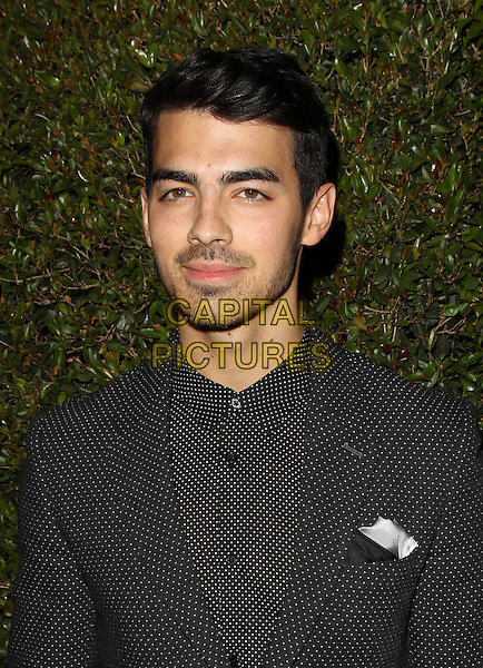 West Hollywood, CA - FEBRUARY 25: Joe Jonas Attending BVLGARI Presents &quot;Decades Of Glamour&quot;, Held at Soho House California on February 25, 2014. Photo Credit:Sadou/UPA/MediaPunch<br /> CAP/MPI/SAD/UPA<br /> &copy;Sadou/UPA/MediaPunch/Capital Pictures