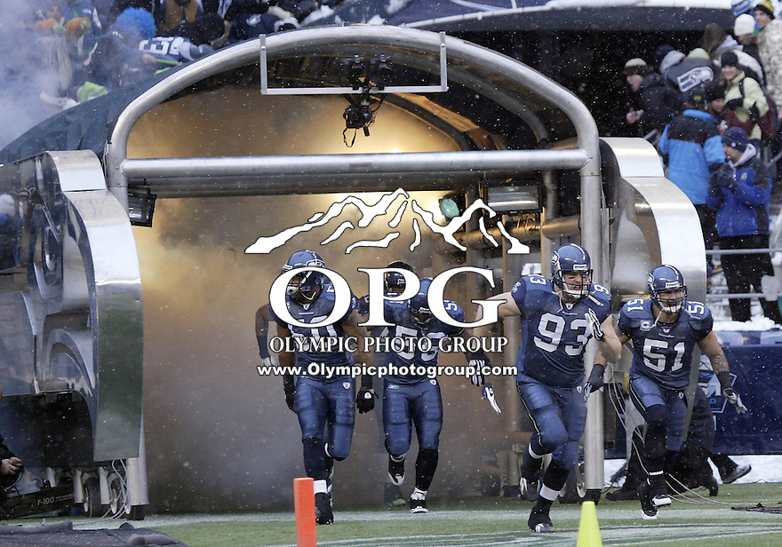 December 21, 2008:  Seattle Seaahwks players run out of the Seahawks Tunnel before the game against NY Jets at Quest Field in Seattle, WA.  Seattle won 13-3 over the NY Jets.