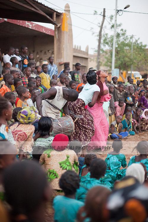 Festivities are in the air the day before the arrival of President Amadou Toumani Toure in Djenne, Mali; women dance in a traditional dance circle.