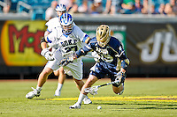 February 20, 2011:  Notre Dame attack Ryan Foley (15) tries to pick up a loose ball from Duke defender Chris Hipps (27) during Lacrosse action between the Duke Blue Devils and Notre Dame Fighting Irish during the Moe's Southwest SunShine Classic played at EverBank Field in Jacksonville, Florida. Notre Dame defeated Duke 12-7.