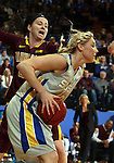 BROOKINGS, SD - MARCH 27:  Mariah Clarin #40 from South Dakota State University looks to pass away from the defense of Joanna Hedstrom #22 from the University of Minnesota in the first half of their sweet sixteen gameThursday night at Frost Arena in Brookings. (Photo by Dave Eggen/Inertia)