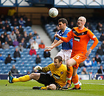 David Healy chases the ball as Gary Kenneth collides with Dusan Pernis