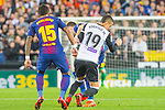 Jose Paulo Bezerra Maciel Junior, Paulinho, of FC Barcelona competes for the ball with Rodrigo Moreno of Valencia CF during the La Liga 2017-18 match between Valencia CF and FC Barcelona at Estadio de Mestalla on November 26 2017 in Valencia, Spain. Photo by Maria Jose Segovia Carmona / Power Sport Images