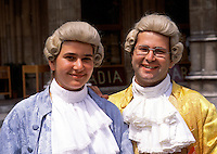 Portrait of two smiling Austrian men in period costumes for the Mozart Music Festival. Vienna, Austria.