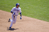 Florida Gators shortstop Richie Martin (12) runs to third base against the Virginia Cavaliers in Game 11 of the NCAA College World Series on June 19, 2015 at TD Ameritrade Park in Omaha, Nebraska. The Gators defeated Virginia 10-5. (Andrew Woolley/Four Seam Images)