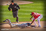 27 April 2014: Washington Nationals shortstop Ian Desmond gets Chris Denorfia out at second on a double play in the 9th inning against the San Diego Padres at Nationals Park in Washington, DC. The Padres defeated the Nationals 4-2 to to split their 4-game series. Mandatory Credit: Ed Wolfstein Photo *** RAW (NEF) Image File ***