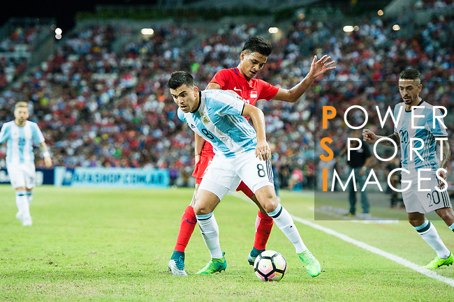 Marcos Acuna of Argentina (L) fights for the ball with Safuwan Baharudin of Singapure (R) during the International Test match between Argentina and Singapore at National Stadium on June 13, 2017 in Singapore. Photo by Marcio Rodrigo Machado / Power Sport Images