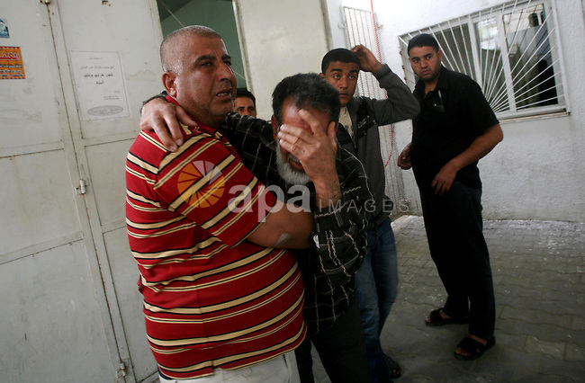 Relatives of of Mohammed al-Hasoma, 65, mourn during his funeral in Beit Lahiya, northern Gaza Strip, Monday, March 12, 2012. The cross-border violence, touched off by Israel's killing of a top militant leader on Friday, has been the worst exchange of fire between Israel and the Hamas-ruled territory in months. Photo by Ashraf Amra
