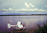 BOTSWANA, Africa, Okavango Delta, A float plane by a dock near Moremi