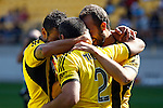 Phoenix players, Vince Lia, left, Manny Muscat, centre and Andrew Durante, right, celebrate after Muscat scores against the Brisbane Roar in the A-League football match at Westpac Stadium, Wellington, New Zealand, Sunday, January 04, 2015. Credit: Dean Pemberton