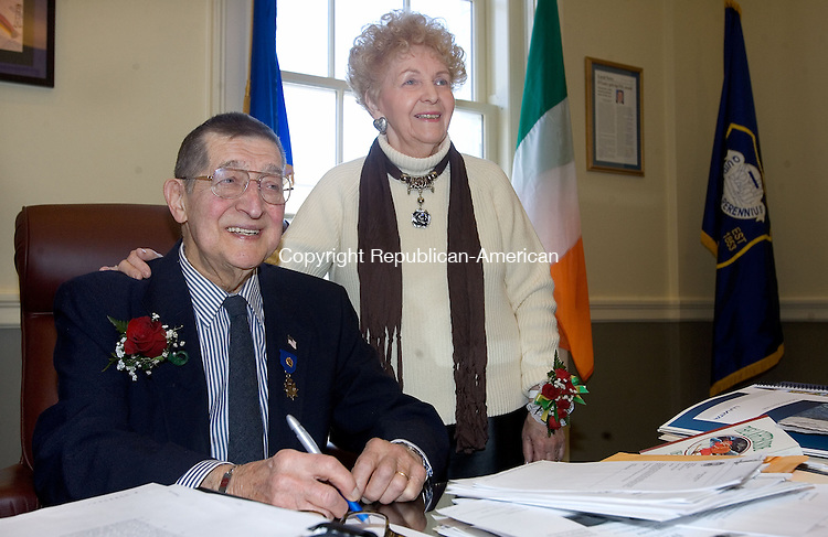 WATERBURY, CT. 15 February 2013-021513SV06-Edward J. Bebrin of Waterbury, Lithuanian Mayor for the Day, sits at the Mayors Desk with his wife Betty Bebrin at his side in Waterbury Friday. Bebrin a longtime member of the Knights of Lithuania has been named the Lithuanian Mayor for the Day, and was be honored at a ceremony in City Hall..Steven Valenti Republican-American