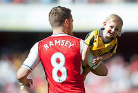 Aaron Ramsey of Arsenal and son after the match.  English Premier League Emirates Stadium, London,  Britain 21st May 2017.