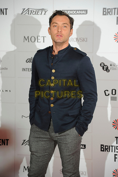 Jude Law.Independent Film Awards, Old Billingsgate Market, London, England..December 9th, 2012.half length blue jacket military grey gray trousers hands in pockets .CAP/CAS.©Bob Cass/Capital Pictures.