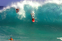 Two body boarders get caught in the backwash at the shore break at Sandy beach on the east coast on the island of Oahu, Hawaii.