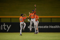 AZL Giants Orange outfielders Najee Gaskins (32), Javeyan Williams (34), and Tyler Wyatt (83) celebrate a victory after an Arizona League game against the AZL Cubs 1 on July 10, 2019 at Sloan Park in Mesa, Arizona. The AZL Giants Orange defeated the AZL Cubs 1 13-8. (Zachary Lucy/Four Seam Images)