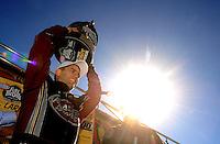 Nov 14, 2010; Pomona, CA, USA; NHRA top fuel dragster driver Larry Dixon celebrates after winning the 2010 top fuel championship during the Auto Club Finals at Auto Club Raceway at Pomona. Mandatory Credit: Mark J. Rebilas-