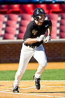 Aaron Fossas #18 of the Wake Forest Demon Deacons hustles down the first base line during an intrasquad scrimmage at Wake Forest Baseball Park on January 29, 2012 in Winston-Salem, North Carolina.  (Brian Westerholt / Four Seam Images)