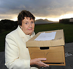 22-10-2010:Maureen Haughey hands over papers belonging to her husband Charles to Minister Martin Manseragh at The Blasket Island Centre in Dun Chaoin, Dingle, County Kerry, with The Great Blasket Island in the background on Friday. The papers relate to Inis Mhicaleann and West Kerry.<br /> Picture by Don MacMonagle