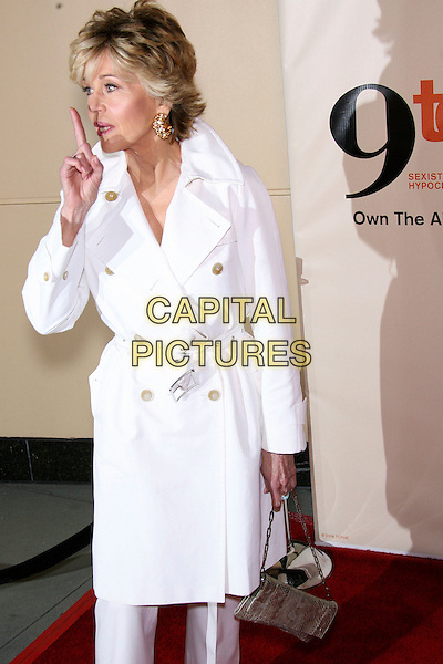 """JANE FONDA.""""9 to 5"""" Special Edition DVD Release Party held at the Annex, Hollywood, California, USA..March 30th, 2006.Photo: Zach Lipp/AdMedia/Capital Pictures.Ref: ZL/ADM.half length white coat quiet hand gesture.www.capitalpictures.com.sales@capitalpictures.com.© Capital Pictures."""