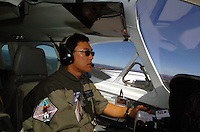 Oct 13, 2004 - Over Northern California, CA, USA - Coast Guard Auxiliary Pilot JERRY KUROTA of Pleasanton flys a patrol mission over the Northern California coast. The Livermore-based crew will ramp up their flights over coastal waters as the November elections near..(Credit Image: © Alan Greth)