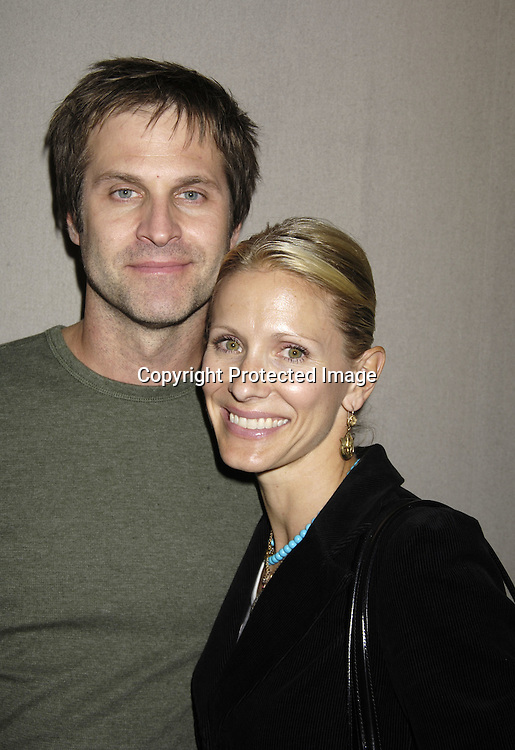 Jon and Kelley Hensley ..at at reception in honor of Mary Alice Dwyer-Dobbin on her ..leaving P and G on September 29, 2005 at the offices of ..P and G. ..Photo by Robin Platzer, Twin Images