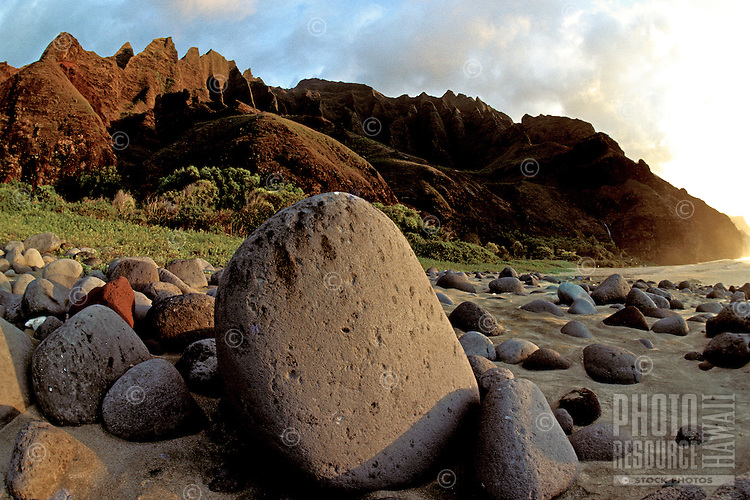Large pohaku (rock or stone in Hawaiian) on pristine Kalalau beach on the remote Na Pali coastline of Kauai.
