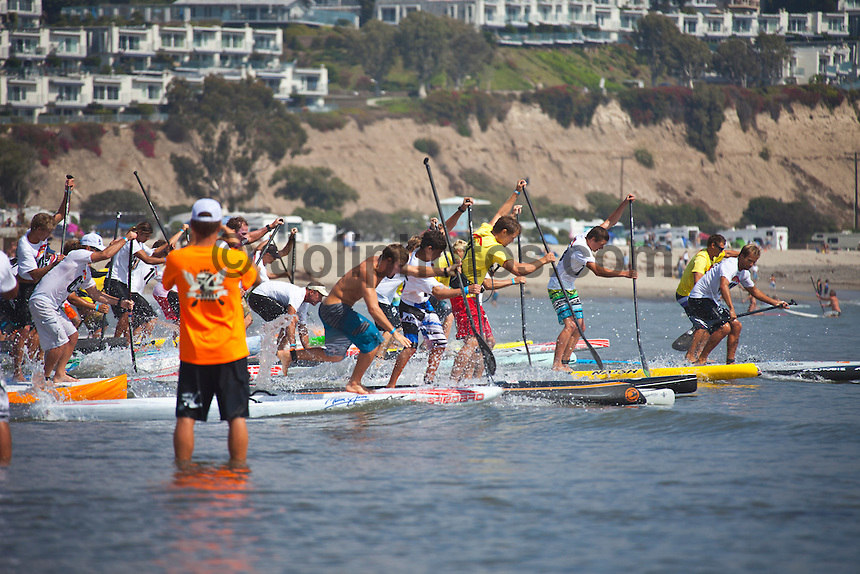 Dana Point, CA -- (Sept. 24, 2011) Start of elite race. -- Maui's Connor Baxter, 17, won his first major stand-up paddle (SUP) championship today against the world's best in the Rainbow Sandals Gerry Lopez Battle of the Paddle in California..In the most thrilling Elite Race battle in the four-year history of the event, Baxter fought off none other than 10x world prone paddleboard champion Jamie Mitchell (Australia), and defending Battle of the Paddle.California champion Danny Ching (California) to win. The women's Elite Race was won with by an incredibly inform Candice Appleby (Oahu/San Clemente) for.the fourth consecutive year....Competing under a new qualifying round format, Elite racers paddled through a two-mile qualifier heat before taking to the final 3-mile buoy course for.the championship. Prior to today, the Battle of the Paddle Elite Race was a straight final, but ever-increasing participation called for an extended.format that went over well with the athletes. Photo: joliphotos.com