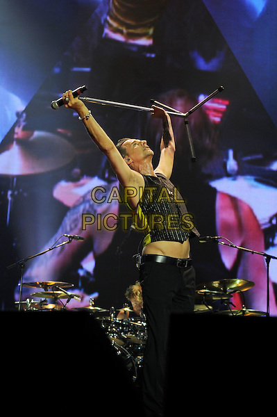 Dave Gahan of Depeche Mode performing in concert, o2 Arena, Greenwich, London, England. .28th May 2013.on stage live gig performance music half length black waistcoat microphone stand holding above head arms in air tattoos full trousers profile .CAP/MAR.© Martin Harris/Capital Pictures.