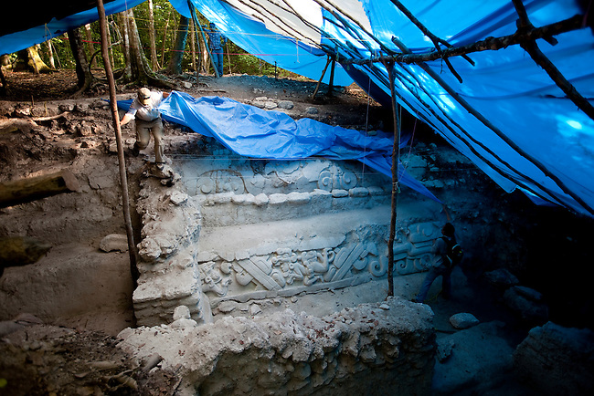 Archeologists peel back a tarp from a recent discovery. Only a tiny portion of the cities within the Mayan Biosphere have been excavated.